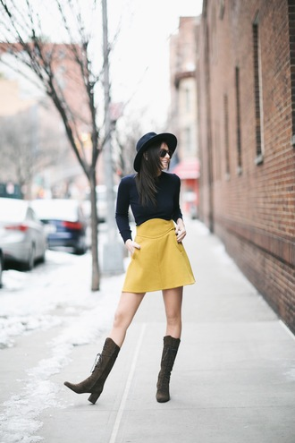 we wore what blogger sweater yellow skirt lace-up shoes lace up boots skirt shoes