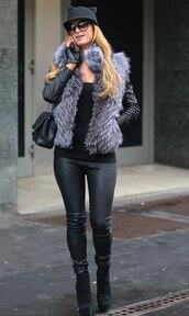paris hilton,gloves,fur vest,leather pants,tank top,jacket,pants,sunglasses,hat,grey fur vest,black hat,leather gloves