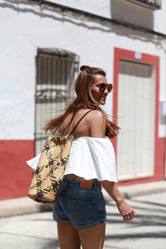 b a r t a b a c blogger denim shorts summer outfits off the shoulder top white top raffia bag backpack summer accessories