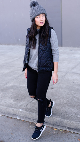 the fancy pants report blogger sweater jacket hat jeans shoes quilted vest beanie pom pom beanie grey sweater black jeans ripped jeans skinny jeans black vest