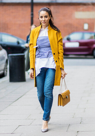 coat london fashion week 2017 fashion week 2017 fashion week streetstyle yellow yellow coat yellow bag bag bulgari serpenti bag denim jeans blue jeans pumps high heel pumps shirt white shirt top tube top stripes striped top