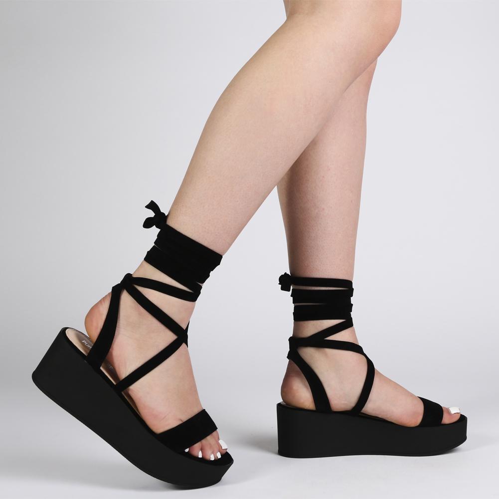 Diya Flatform Sandals in Black Faux Suede