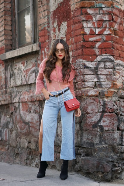 jeans tumblr light blue jeans cropped jeans culottes side split top blouse pink blouse boots black boots bag red bag crossbody bag