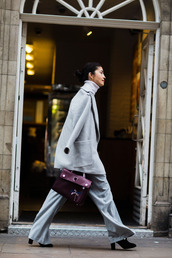 coat,fashion week street style,fashion week 2016,fashion week,london fashion week 2016,grey coat,pants,grey pants,wide-leg pants,boots,black boots,high heels boots,bag,burgundy,burgundy bag,turtleneck,fall outfits,office outfits,work outfits,streetstyle,winter work outfit