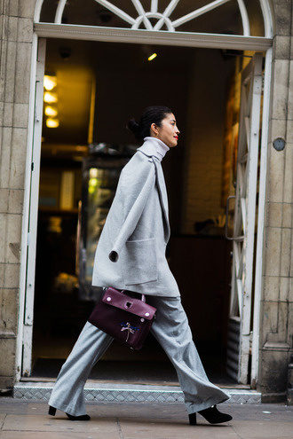 coat fashion week street style fashion week 2016 fashion week london fashion week 2016 grey coat pants grey pants wide-leg pants boots black boots high heels boots bag burgundy burgundy bag turtleneck fall outfits office outfits work outfits streetstyle winter work outfit