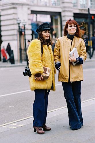 vanessa jackman blogger coat hat jacket yellow yellow coat fuzzy coat flare pants navy navy pants 60s style