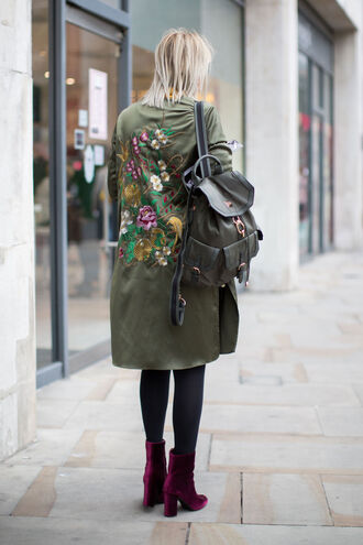 jacket fashion week street style fashion week 2016 fashion week army green jacket embroidered embroidered jacket backpack green backpack tight boots velvet velvet boots high heels boots burgundy streetstyle opaque tights coat tumblr grey coat parka tights thick heel block heels ankle boots purple