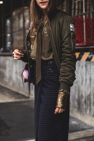 jacket tumblr bomber jacket khaki bomber jacket army green jacket skirt midi skirt stripes striped skirt blue skirt wrap skirt metallic blouse gold blogger fall outfits glitter