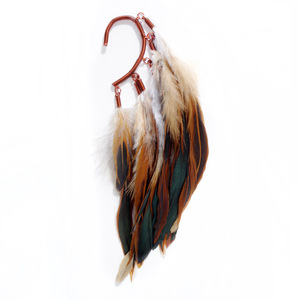 Anni jã¼rgenson — ear cuff with burnt red rooster feathers