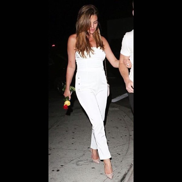 jumpsuit celebrity lovesadores white white jumpsuit off the shoulder celebrity style outfit date outfit clubwear outfit of the evening
