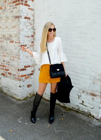 fash boulevard blogger top skirt coat shoes sunglasses bag fall outfits crossbody bag bell sleeves mini skirt yellow skirt boots