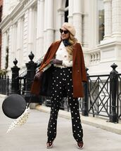 hat,beret,shoes,oxfords,black and white,pants,polka dots,white sweater,brown coat,black bag,scarf,sunglasses
