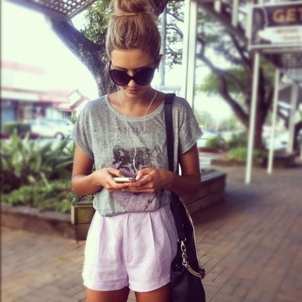 shorts white shorts casual high waisted shirt wolf girl lavender shorts blonde hair bun sunglasses black bag phone t-shirt grey trendy grey bag grey t-shirt shoulder bag sweater