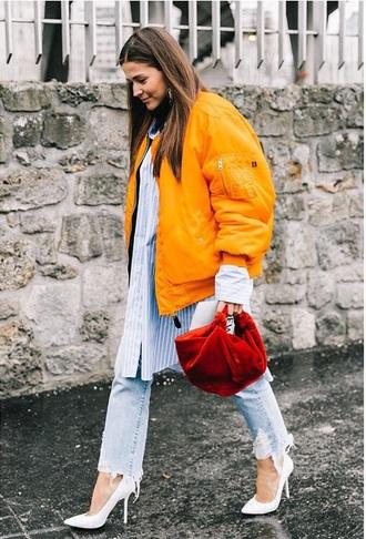 jacket orange jacket shirt oversized oversized shirt striped shirt white boots bomber jacket jeans blue jeans boots