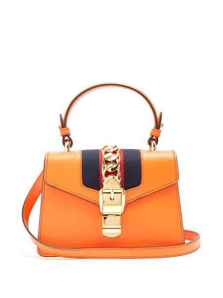 9091f5bbeede GUCCI Sylvie mini leather shoulder bag in orange - Wheretoget