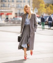 coat,wool coat,long coat,stripes,pumps,asymmetrical skirt,oversized shirt,striped shirt,handbag