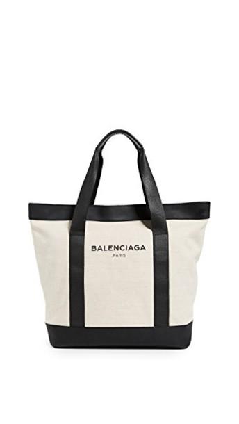 black cream bag