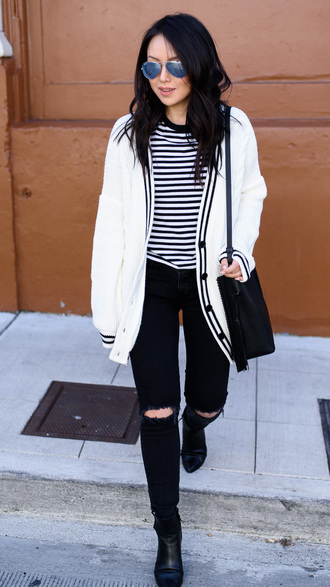 the fancy pants report blogger cardigan bag white jacket striped top black jeans ripped jeans black bag black boots
