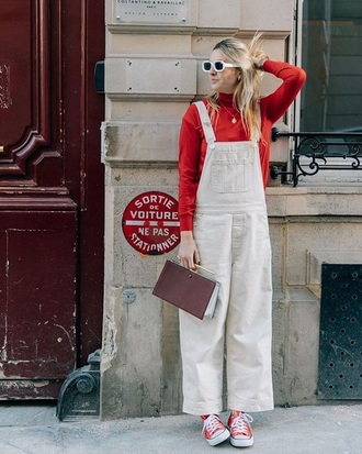 jeans white overalls top turtleneck red top shoes bag white sunglasses sunglasses overalls dungarees