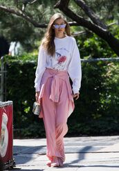 sunglasses,pants,pink,sweater,top,gigi hadid,model off-duty,streetstyle,wide-leg pants,sneakers,spring outfits