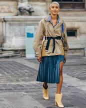skirt,satin,asymmetrical skirt,pleated skirt,ankle boots,mid heel boots,oversized jacket,striped shirt,earrings,shoulder bag,belt