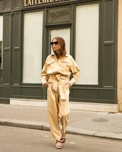 jumpsuit,yellow jumpsuit,long sleeves,sunglasses,bag,shoes
