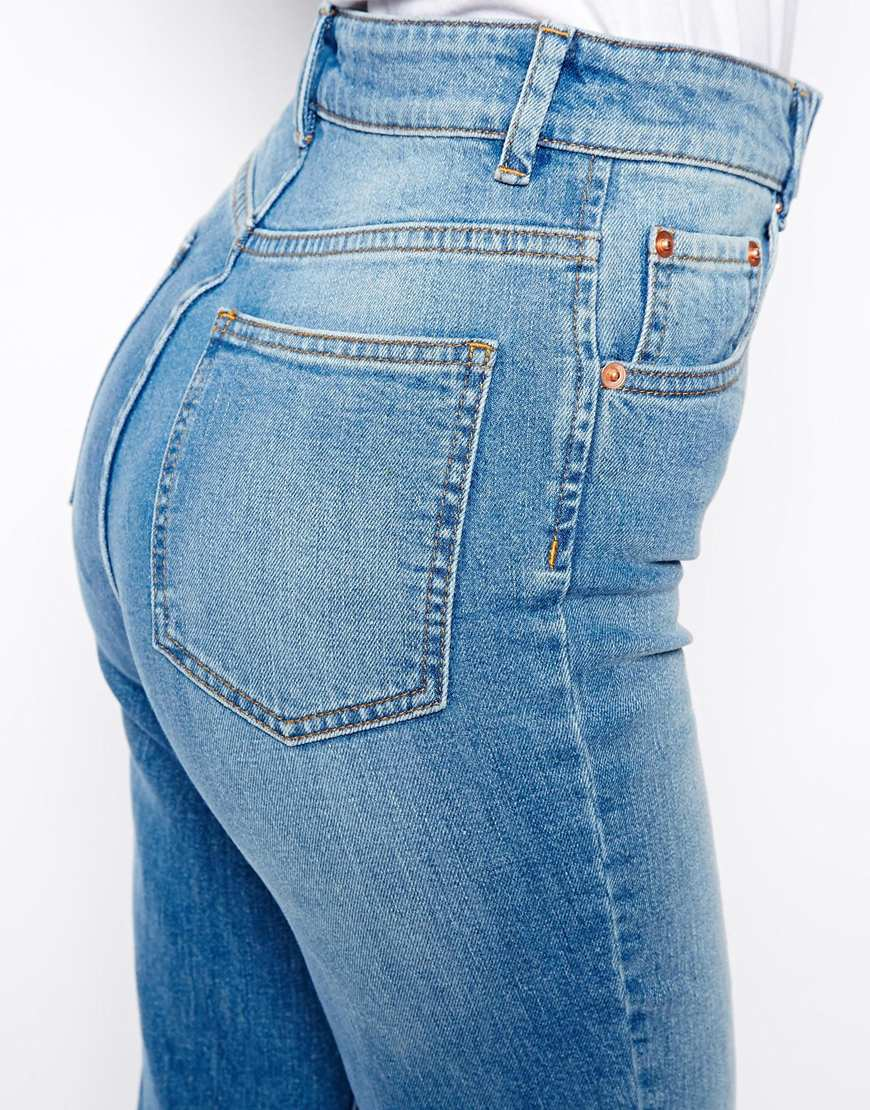 ASOS Farleigh High Waist Slim Mom Jeans In Mid Wash Blue With Busted Knees at asos.com