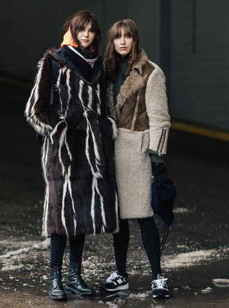 coat nyfw 2017 fashion week 2017 fashion week streetstyle printed coat leggings black leggings boots black boots flat boots tights opaque tights sneakers black sneakers grey coat scarf winter outfits winter coat winter look