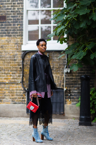 shoes fashion week street style fashion week 2016 fashion week london fashion week 2016 blue boots high heels boots thick heel block heels bag red bag black leather jacket leather jacket jacket black jacket skirt midi skirt black skirt shirt ankle boots