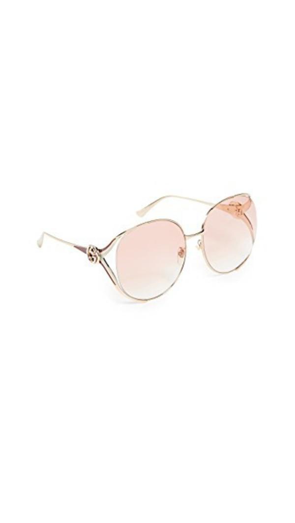 Gucci Urban Folk Oval Sunglasses in gold / orange