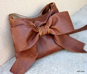 bag,bow,bow bag,brown bag,leather bag,black,leather,peplum,chique