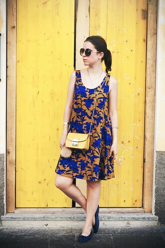 once upon a time blogger bag dress sunglasses short dress summer dress summer outfits floral dress sleeveless dress yellow bag crossbody bag furla furla bag round sunglasses keychain fur keychain flats ballet flats blue flats mustard dress bag accessories