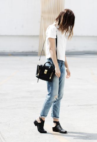 take aim blogger ripped jeans white t-shirt black bag casual cut out ankle boots