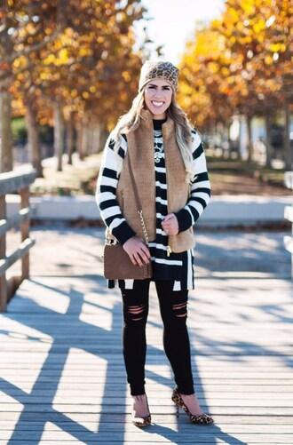herestheskinny blogger sweater jacket jeans bag shoes hat jewels make-up beanie vest shoulder bag leopard print high heels