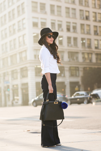wendy's lookbook blogger hat wide-leg pants white shirt sunglasses jewels