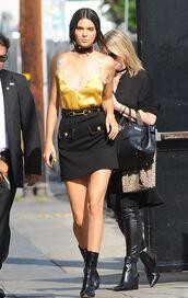 top,camisole,tank top,summer top,skirt,kendall jenner,boots,choker necklace,mini skirt,black skirt,yellow top