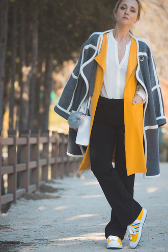 my blonde gal blogger grey coat yellow coat white blouse black pants sneakers white bag rebecca minkoff