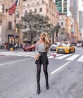 skirt,mini skirt,black skirt,high waisted skirt,slit skirt,belt,striped top,off the shoulder,crossbody bag,ankle boots,black boots,tights