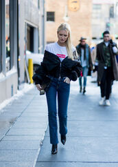 t-shirt,nyfw 2017,fashion week 2017,fashion week,streetstyle,supreme,logo tee,logo,white t-shirt,jacket,black jacket,bomber jacket,black bomber jacket,denim,jeans,blue jeans,boots,black boots,pointed boots,bag,black bag,00s style