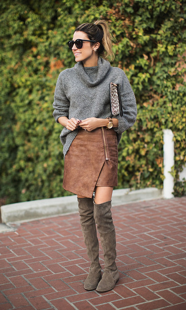 hello fashion blogger skirt grey sweater asymmetrical zip thigh high boots winter boots winter outfits sweater shoes cardigan zipped skirt zip-up skirt over the knee boots khaki boots printed pouch pouch turtleneck sweater suede skirt asymmetrical skirt flat boots