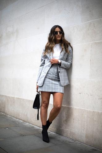 skirt grey skirt grey blazer blazer white top top sunglasses black bag bag black boots checkered checkered skirt