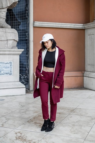 hat white cap black crop top burgundy coat burgundy trousers buckle boots blogger