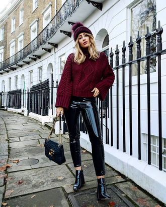 sweater tumblr knit knitwear knitted sweater burgundy burgundy sweater beanie pom pom beanie pants black pants vinyl black vinyl pants