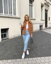 coat,faux fur coat,jeans,high waisted jeans,white sneakers,crop tops,handbag