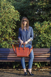 a portable package,blogger,jeans,bag,sunglasses,denim,red bag,black heels,denim shirt