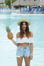 dulceida,blogger,hat,crop tops,white crop tops,denim shorts,spring break,summer outfits,nastygal,pineapple,bandeau,peasant top,off the shoulder top,white off shoulder top,off the shoulder,cropped,ruffle,ruffled top,straw hat,sun hat,blue shorts,necklace