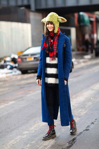 coat nyfw 2017 fashion week 2017 fashion week streetstyle blue long coat long coat blue coat sweater stripes striped sweater scarf tartan scarf tartan hat boots black boots biker boots denim jeans black jeans skinny jeans
