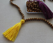 jewels,tassel,wood,necklace,wood bead,mala,pants,leather tassel,leather,leather kychain,red