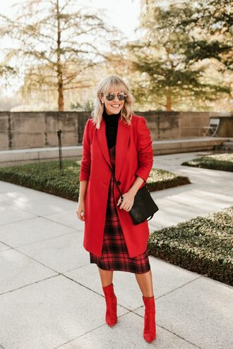 the courtney kerr blogger bag dress coat shoes sunglasses fall outfits red coat black bag crossbody bag boots red boots plaid dress steve madden