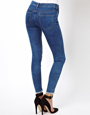 ASOS | ASOS Ridley High Waist Ultra Skinny Ankle Grazer Jeans in Blue with Ripped Raw Hem at ASOS